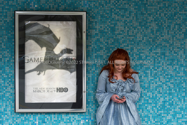 "3/21/2013--Seattle, WA, USA...Anastacia Ferry, dressed as ""Sansa Stark"", a character from HBO's series ""Game of Thrones"" waits outside the Cinerama cinema in Seattle, WASH, for the premier of season 3....©2013 Stuart isett. All rights reserved."