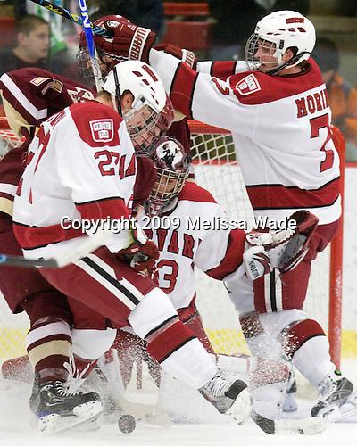 Pat Mullane (BC - 11), Michael Biega (Harvard - 27), Kyle Richter (Harvard - 33), Chad Morin (Harvard - 7) - The Boston College Eagles defeated the Harvard University Crimson 3-2 on Wednesday, December 9, 2009, at Bright Hockey Center in Cambridge, Massachusetts.