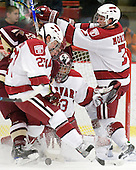 Pat Mullane (BC - 11), Michael Biega (Harvard - 27), Kyle Richter (Harvard - 33), Chad Morin (Harvard - 7) - The Boston College Eagles defeated the Harvard University Crimson 3-2 on Wednesday, December 9, 2009, at Bright Hockey Center in Cambridge, Massachusetts.