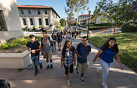 Upward Bound students make their way across the Oxy campus between classes. The summer program offers an intensive and social way for participants to get a leg up on life. The program is for high school students who have an interest in attending college when they graduate, helping them navigate problems big and small. Photo taken on June 22, 2015 for an Occidental Magazine article.<br />