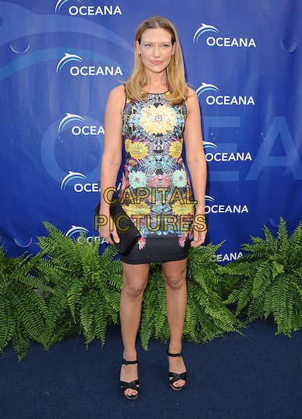 Anna Torv<br /> 6th Annual Oceana SeaChange Gala held at a Private Villa, Laguna Beach, California, USA.     <br /> August 18th, 2013<br /> full length dress clutch bag blue black yellow floral sleeveless print<br /> CAP/DVS<br /> &copy;DVS/Capital Pictures