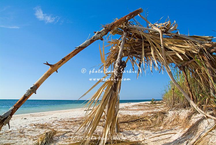 Old wooden shelter on a white sand beach, Cayo Jutias, Cuba.