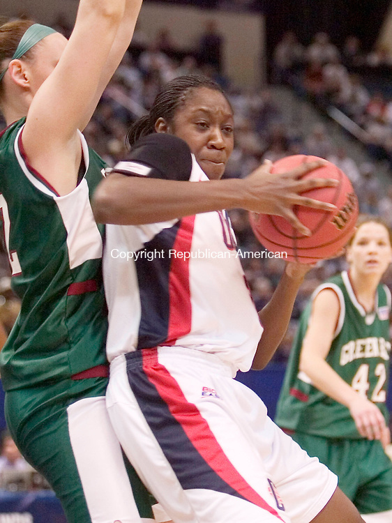 HARTFORD, CT. 20 March 2007-032007SV11--#31 Tina Charles of UConn goes to the hoop as #32 Nicole Soulis of Wisconsin Green Bay defends during the second round of NCAA action at the Civic Center in Hartford Tuesday.<br /> Steven Valenti Republican-American