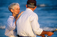 Senior couple spending time together and surf fishing.