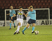 Ross Drummond gets the better of Lewis Morgan in the St Mirren v Dunfermline Athletic Scottish Professional Football League Under 20 match played at the Excelsior Stadium, Airdrie on 11.12.13.