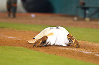 Pat Blair #11 of the Wake Forest Demon Deacons lies on the ground after making the final out in the game against the Miami Hurricanes at NewBridge Bank Park on May 25, 2012 in Winston-Salem, North Carolina.  The Hurricanes defeated the Demon Deacons 6-3.  (Brian Westerholt/Four Seam Images)
