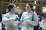 12 February 2017: UNC's Diana Philpot (right) and Meredith Bozentka (left) during Saber. The Duke University Blue Devils hosted the University of North Carolina Tar Heels at Card Gym in Durham, North Carolina in a 2017 College Women's Fencing match. Duke won the dual match 14-13 overall and 7-2 in Epee. UNC won Foil 6-3 and Saber 5-4.
