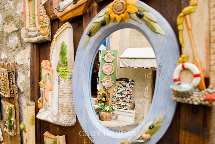 reflection in mirror of tourist shop in Gourdon, France