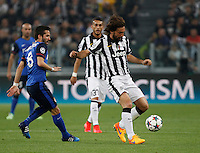 Calcio, quarti di finale di andata di Champions League: Juventus vs Monaco. Torino, Juventus stadium, 14 aprile 2015.<br /> Juventus' Andrea Pirlo, right, is chased by Monaco's Joao Moutinho during the Champions League quarterfinals first leg football match between Juventus and Monaco at Juventus stadium, 14 April 2015.<br /> UPDATE IMAGES PRESS/Isabella Bonotto