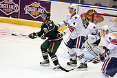 February 24th 2008:  Cal Clutterbuck (8) of the Houston Aeros in front of the net defended by Mike Funk (4) as Goalie Tyler Plante (31) looks for the puck during a game vs. the Rochester Amerks at Blue Cross Arena at the War Memorial in Rochester, NY.  The Aeros defeated the Amerks 4-0.   Photo copyright Mike Janes Photography 2008