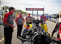 Mar. 30, 2012; Las Vegas, NV, USA: NHRA crew members for top fuel dragster driver Steve Torrence during qualifying for the Summitracing.com Nationals at The Strip in Las Vegas. Mandatory Credit: Mark J. Rebilas-