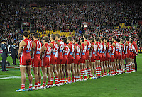 The Sydney Swans line up before kickoff during the Australian Rules Football ANZAC Day match between St Kilda Saints and Sydney Swans at Westpac Stadium, Wellington, New Zealand on Thursday, 24 May 2013. Photo: Dave Lintott / lintottphoto.co.nz