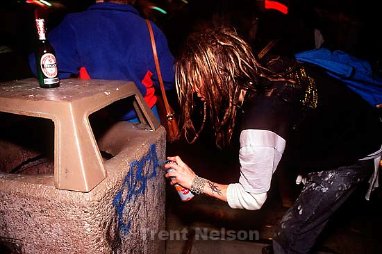 Spray painting a garbage can during Anti war Gulf War protests.   &amp;#xA;<br />
