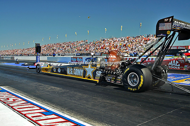 NHRA drag races at Memphis Motorsports Park Army top fuel car driven by Tony Schumacher.
