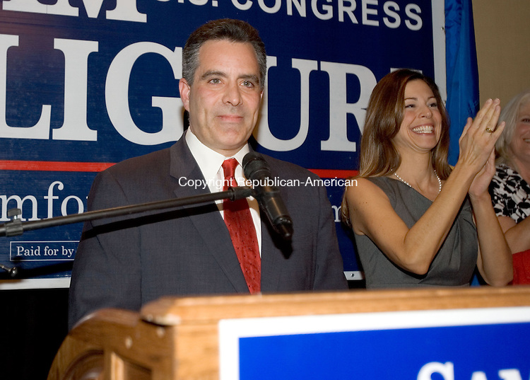 WATERBURY, CT. 02 November 2010-110210SV05--Sam S. F. Caligiuri thanks supporter after loosing to Congressman Chris Murphy in the 5th congressional district race in Waterbury Tuesday. At right, Sam&rsquo;s wife Lori Caligiuri.<br /> Steven Valenti Republican-American