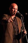 © Joel Goodman - 07973 332324 . 19/07/2013 . Suffolk , UK . Liverpool poet GERRY POTTER in the Poetry Tent . The Latitude music and culture festival in Henham Park , Southwold . Photo credit : Joel Goodman