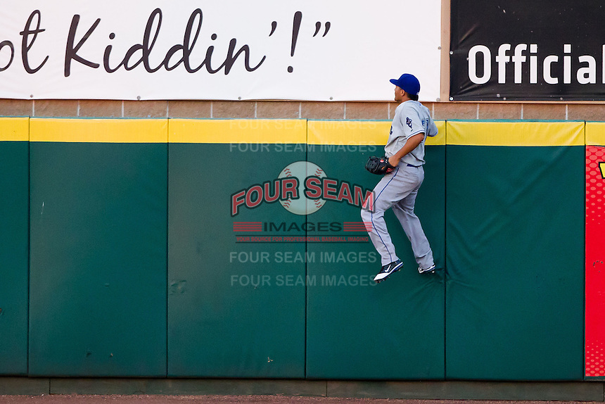 Bronson Sardinha (51) of the Tulsa Drillers jumps up the right field wall during a game against the Springfield Cardinals at Hammons Field on July 20, 2011 in Springfield, Missouri. Springfield defeated Tulsa 12-1. (David Welker / Four Seam Images)