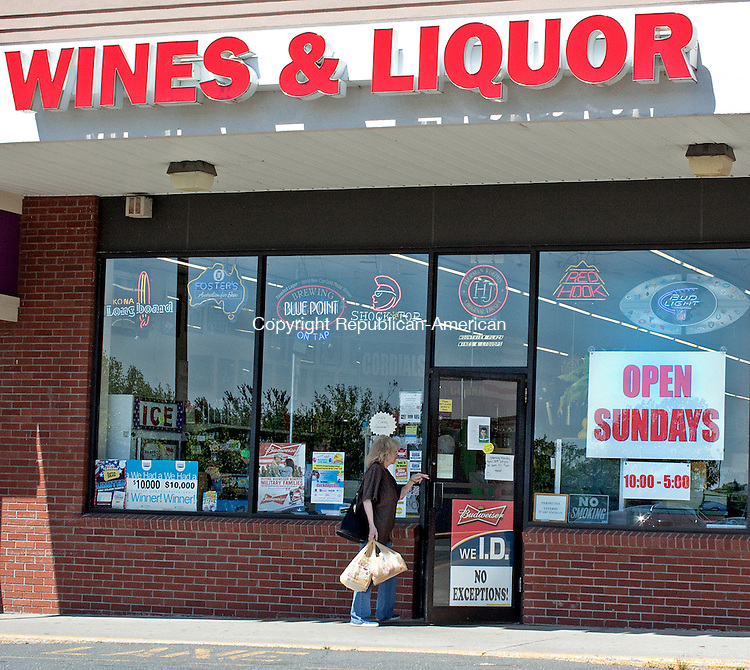 "NAUGATUCK, CT- MAY 17  2011-051712DA08- A large ""Open Sunday"" sign hangs in the store front of Mount View Wines & Liquor in the Mount View Plaza in Naugatuck after Governor Dannel P. Malloy signed Sunday liquor sales into law earlier this week. .Darlene Douty Republican American"