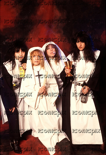 GIRLSCHOOL - L-R: Chris Bonacci, Tracey Lamb, Denise Dufort, Kim McAuliffe - photosession dressed as nuns - 1988.  Photo credit: Ray Palmer Archive/IconicPix