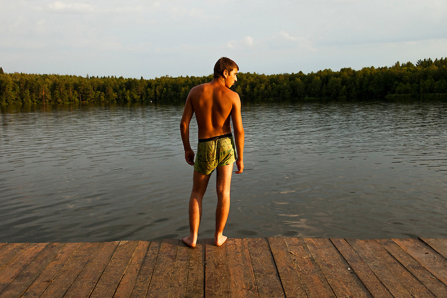 Novy Gorky, Ivanova Region, Russia, 04/08/2012..Weekend swimmers in Lake Seletskoye near the town of Novy Gorky,  some 200 miles east of Moscow.