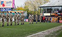 Officials and players enter the field through a military guard of honour ahead of the Sky Bet League 2 match between Newport County and Carlisle United at Rodney Parade, Newport, Wales on 12 November 2016. Photo by Mark  Hawkins.