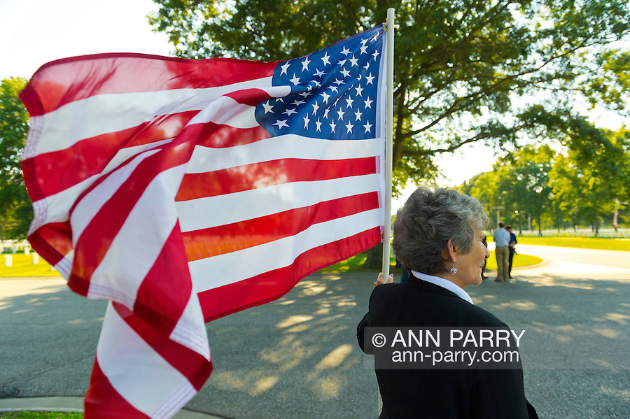 Aug. 18, 2012 - Farmingdale, New York, U.S.: ELIZABETH SCHMANSKI, a member of the Patriot Guard Riders, is one of hundreds who attend the burial ceremony of Marine Lance Corporal Greg Buckley Jr, 21 - the Oceanside native killed in Afghanistan 9 days earlier - at Long Island National Cemetery.