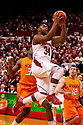 12 February 2011: Nebraska Cornhuskers guard Lance Jeter #34 with a lay up against the Oklahoma State Cowboys during the first half at the Devaney Sports Center in Lincoln, Nebraska. Nebraska defeated Oklahoma State 65 to 54.