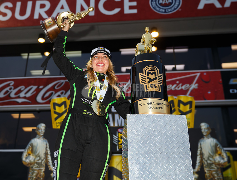 Nov 12, 2017; Pomona, CA, USA; NHRA top fuel driver Brittany Force celebrates after winning the 2017 top fuel world championship and the Auto Club Finals at Auto Club Raceway at Pomona. Mandatory Credit: Mark J. Rebilas-USA TODAY Sports