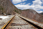 Crawford Notch State Park - Old Maine Central Railroad in the White Mountains, New Hampshire USA. Since 1995 the Conway Scenic Railroad, which provides passenger excursion trains through the notch has been using the tracks. Mount Willard is off in the distance.
