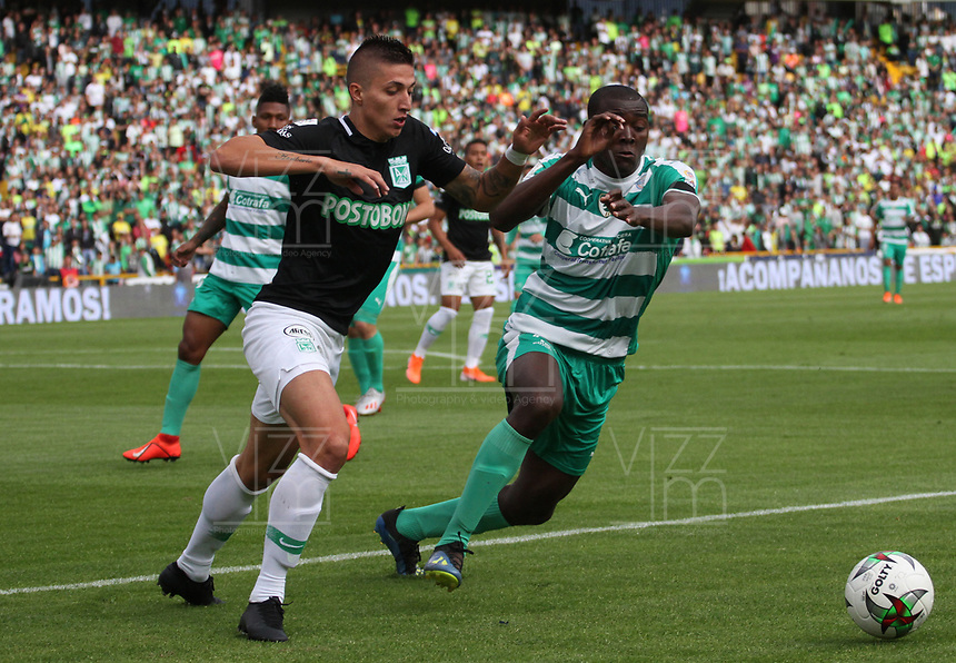 BOGOTÁ - COLOMBIA, 10-08-2019:Danilo Arboleda balón con XXXX (Izq.) jugador del Atlético Nacional durante partido por la fecha 5 de la Liga Águila II 2019 jugado en el estadio Nemesio Camacho El Campín  de la ciudad de Bogotá. /Danilo Arboleda (R) player of La Equidad fights the ball  against of Juan pablo Ramirez  (L) player of Atlético Nacional  during the match for the date 5th of the Liga Aguila II 2019 played at Nemesio Camacho El Campin  stadium in Bogota city. Photo: VizzorImage / Felipe Caicedo / Staff.