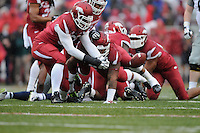NWA Media/ J.T. Wampler -Arkansas picks up a fumble by Ole Miss Saturday Nov. 22, 2014.