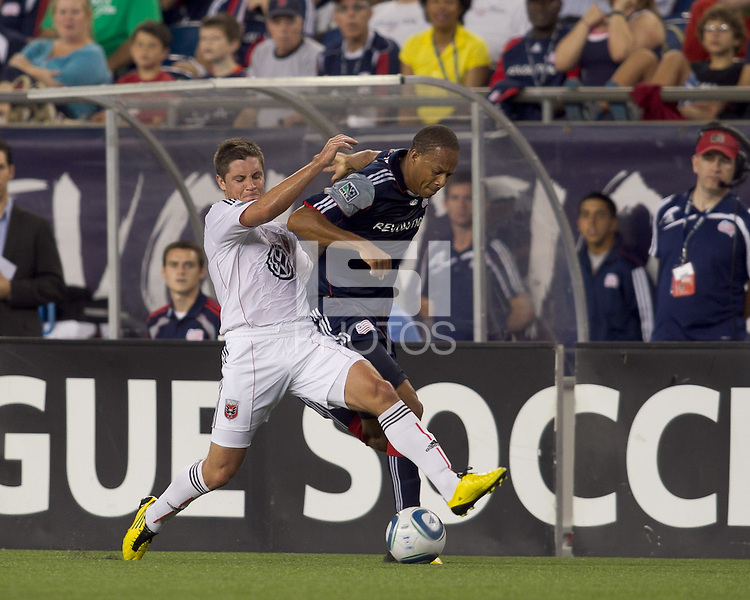 New England Revolution forward Khano Smith (18) fails to dribble beyond DC United midfielder Devon McTavish (18). The New England Revolution defeated DC United, 1-0, at Gillette Stadium on August 7, 2010.