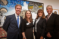 Attending the ribbon cutting ceremony to launch the 'Cuba on My Mind' exhibit at The von Liebig Art Center from left; PNC Senior Vice President, Donald Drury; PNC Community Relations Specialist, Amber Scanlan; PNC Vice President, Senior Relationship Manager, Sharon Treiser; and PNC Managing Executive, Rober Saltarelli, Naples, Florida, USA, March 10, 2011. Photo by Debi Pittman Wilkey