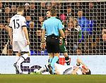 Tottenham's Ben Davies goes off injured during the Europa League match at White Hart Lane Stadium.  Photo credit should read: David Klein/Sportimage