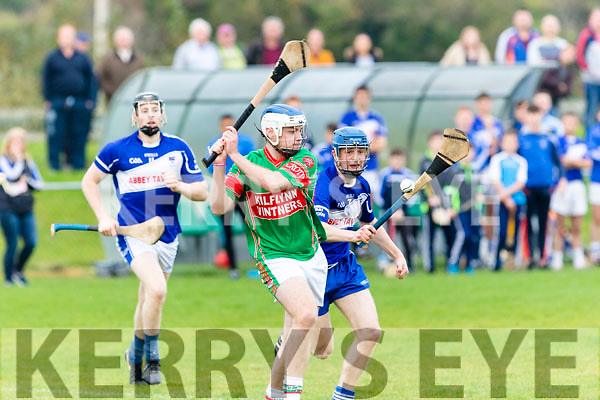 Darragh Ryan, Crotta O'Neill's clears the ball despite the efforts of St Brendans Brendan O'Connor when the sides met last Saturday evening in the U21 county hurling Championship semi final at The John Mitchells GAA ground, Tralee.