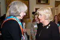 09 March 2016 - London, England - Camilla Duchess of Cornwall, President of WOW, speaks with Britain's Home Secretary Theresa May at a reception for the Women of the World Festival (WOW) at Clarence House, in central London. Photo Credit: Alpha Press/AdMedia