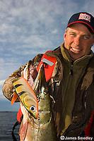 Man fishing large musky