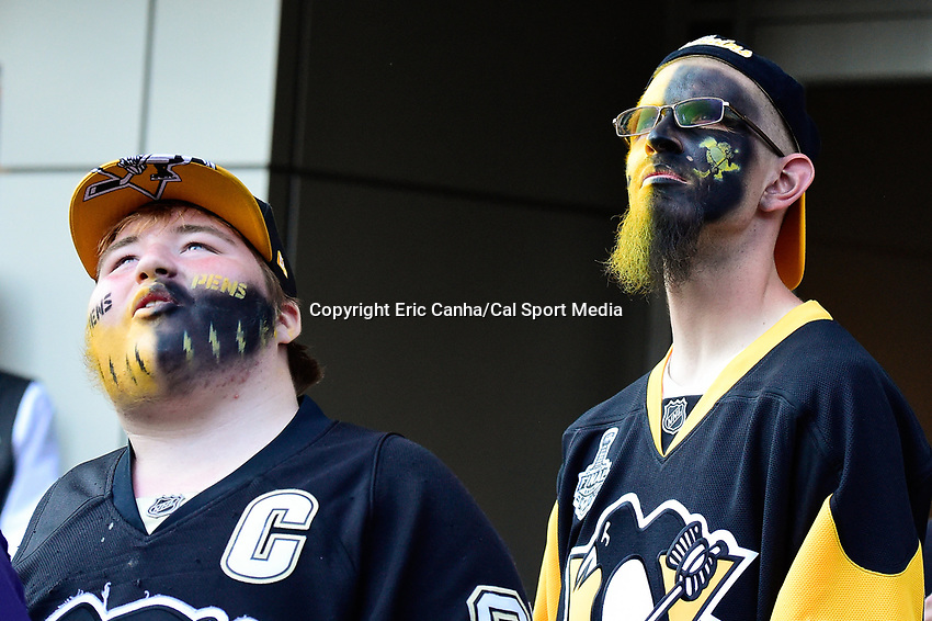 Thursday, June 9, 2016: Pittsburgh Penguins fans watch a large display screen before game 5 of the NHL Stanley Cup Finals  between the San Jose Sharks and the Pittsburgh Penguins held at the CONSOL Energy Center in Pittsburgh Pennsylvania. Eric Canha/CSM