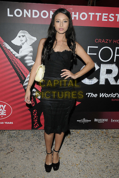 Leah Weller.Forever Crazy by Crazy Horse VIP Gala Night at South Bank, London, England..September 19th 2012.full length black dress ankle strap shoes yellow bag purse hand on hip cat kitty ears .CAP/CAN.©Can Nguyen/Capital Pictures.