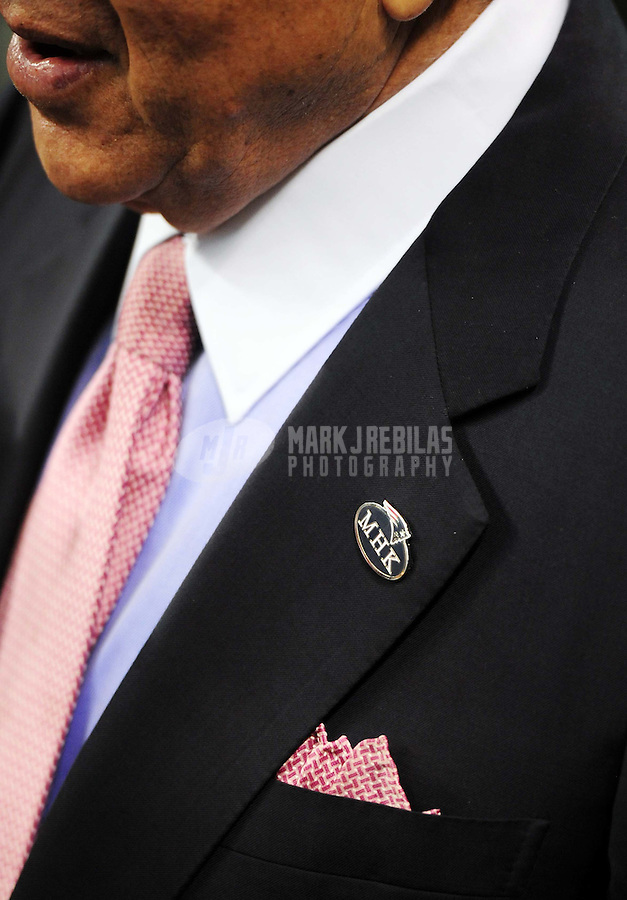 Feb 5, 2012; Indianapolis, IN, USA; A detail view of a pin on New England Patriots owner Robert Kraft remembering his wife Myra Kraft before Super Bowl XLVI against the New York Giants at Lucas Oil Stadium.  Mandatory Credit: Mark J. Rebilas-