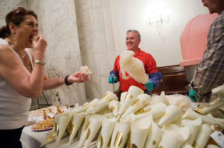 UNITED STATES - JUNE 15:  Cheryl Walsh of FIRST, a robotic competition organization based in Manchester, N.H., samples maple flavored cotton candy from Sweet Water Maple in Candia, N.H., as proprietors the Brian Harrison, center, and his brother Kevin Harrison, look on, before the Second Annual Experience New Hampshire Reception in Russell Building.  The reception is held to showcase New Hampshire businesses, products, and services.  (Photo By Tom Williams/Roll Call)