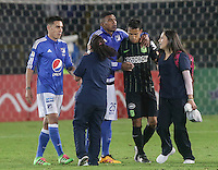 BOGOTA - COLOMBIA -31 - 03 - 2016: Elkin Blanco (Cent.) jugador de Millonarios, se retira de la cancha, durante partido aplazado de la fecha 9 entre Millonarios Atletico Nacional, de la Liga Aguila I-2016, jugado en el estadio Nemesio Camacho El Campin de la ciudad de Bogota.  / Elkin Blanco (C) player of Millonarios, leave the field, during a postponed match between Millonarios and Atletico Nacional, for the date 9 of the Liga Aguila I-2016 at the Nemesio Camacho El Campin Stadium in Bogota city, Photo: VizzorImage / Ivan Valencia / Cont.