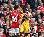 Josh Harrop of Manchester United exchanges words with Wilfried Zaha of Crystal Palace during the English Premier League match at the Old Trafford Stadium, Manchester. Picture date: May 21st 2017. Pic credit should read: Simon Bellis/Sportimage