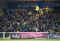 Lincoln City fans watch their team in action<br /> <br /> Photographer Andrew Vaughan/CameraSport<br /> <br /> The EFL Sky Bet League Two - Lincoln City v Exeter City - Tuesday 26th February 2019 - Sincil Bank - Lincoln<br /> <br /> World Copyright © 2019 CameraSport. All rights reserved. 43 Linden Ave. Countesthorpe. Leicester. England. LE8 5PG - Tel: +44 (0) 116 277 4147 - admin@camerasport.com - www.camerasport.com