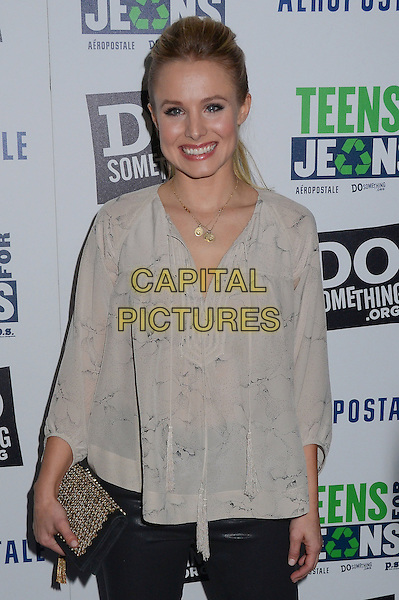 Kristen Bell.DoSomething.org and Aeropostale celebrate launch of 5th Annual 'Teens For Jeans'  at Palihouse, West Hollywood, California, USA..January 10th, 2012.half length white beige top clutch bag blouse print .CAP/ADM/BT.©Birdie Thompson/AdMedia/Capital Pictures.