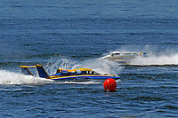"""Kevin Eacret, GP-55  (Grand Prix Hydroplane(s) recovers from a spin in Valleyfield's notorius second turn as Mario Maraldo, GP-59 """"Baby Doll III slips by."""