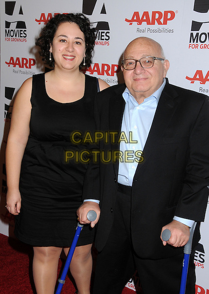 guest & Ben Lewin.AARP Movies For Grownups Awards Luncheon held at The Peninsula Hotel, Beverly Hills, California, USA..February 12th, 2013.half length black dress suit crutches blue shirt glasses .CAP/ADM/BP.©Byron Purvis/AdMedia/Capital Pictures.