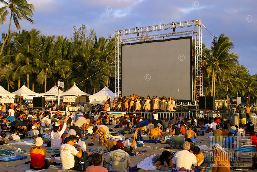 """""""Sunset on the Beach"""" attracts visitors and locals alike to Waikiki Beach to enjoy hula dancing, local food, a movie and of course a beautiful Hawaiian sunset on Oahu."""