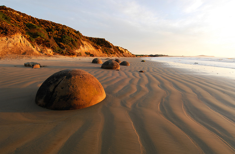 Ripples of sand surround the Moeraki Boulders at low tide, sunrise, Coastal Otago, South Island, New Zealand - stock photo, canvas, fine art print