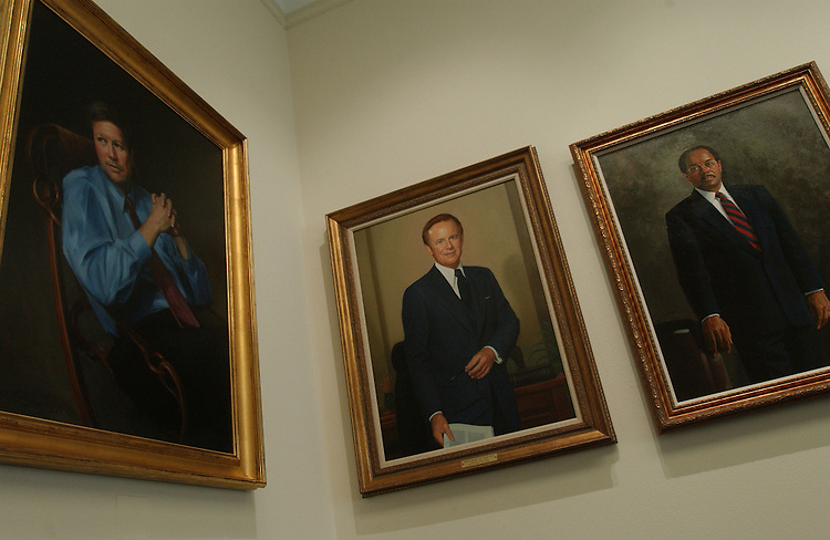 10/8/03.PAST HOUSE BUDGET CHAIRMEN--Portraits of past House Budget chairmen hang in the cloakroom, the room behind the dias of the committee's meeting room. Left to right: John Kasich, R-Ohio, Brock Adams, D-Wash., and Bill Gray, D-Pa., (The portrait of Martin Sabo, D-Minn., is temporarily on display elsewhere.).CONGRESSIONAL QUARTERLY PHOTO BY SCOTT J. FERRELL
